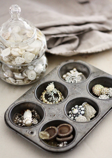 I saw this muffin tin here on Pinterest and wanted one just like it to hold my collection of vintage mother of pearl buttons. I found one identical to this one on etsy. I'm so excited!
