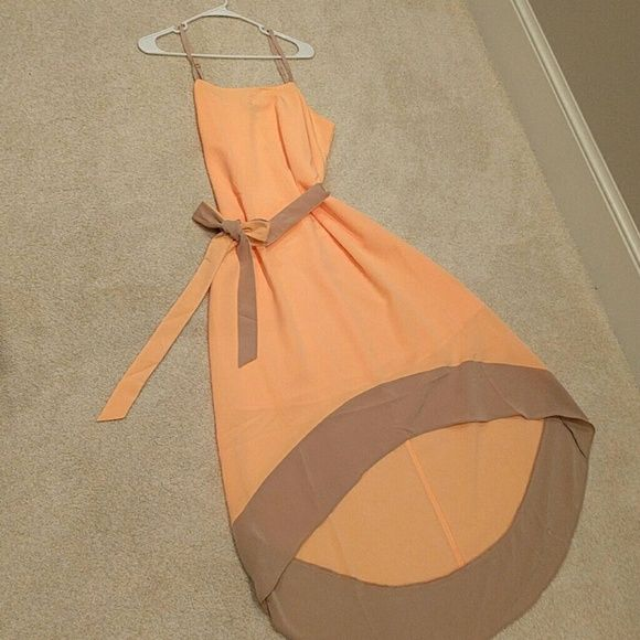 Limited high/low dress This peach and beige summer dress is NWT. Adjustable straps and matching tie around the waste. 100% polyester and lined The Limited Dresses High Low