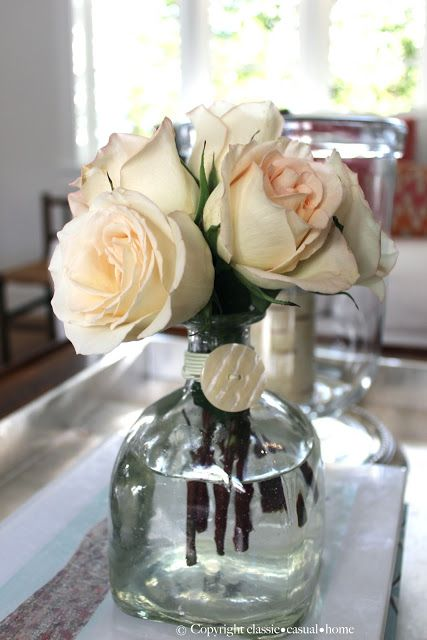 classic • casual • home  Patron tequila bottle vase tied with button and string