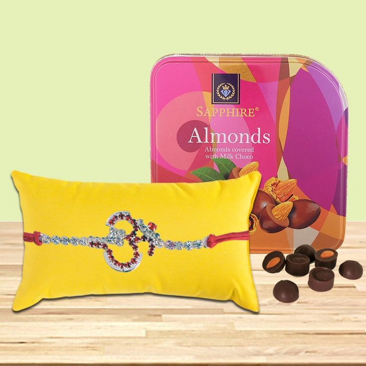 """Make your dearest brother feel loved, cared and special on the auspicious day of #RakshaBandhan  by this unique rakhi choco combo with Saphire Almond Chocolates and Designer OM Silver #Rakhi .  Get 10% off on all rakhi products. #Cuponcode  :""""RAKHI2016""""  #BringHomeFestival"""