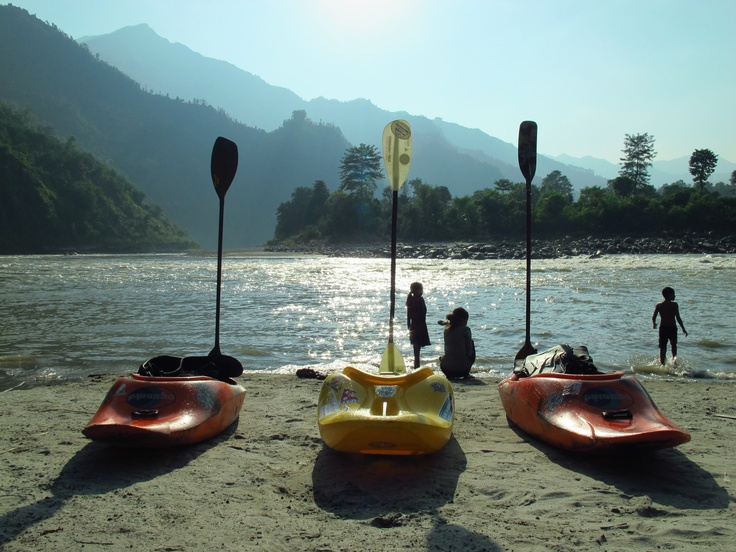 Gettting ready to teach Kayaking Lesson on Trisuli River Nepal.  Guests can learn to kayak in 3 days in our Kayak Bootcamp.