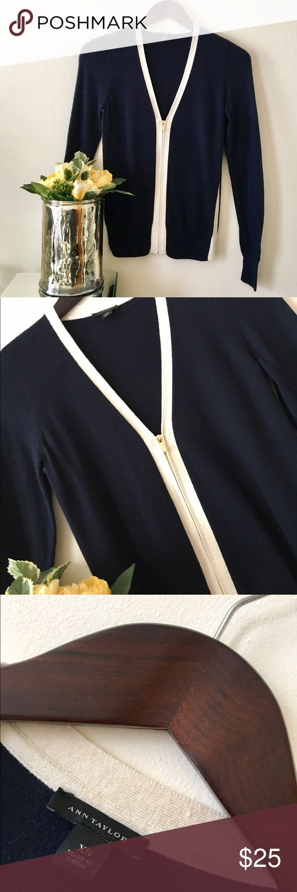 Ann Taylor Navy & Cream Zip Up Cardigan Ann Taylor Navy & Cream Zip Up Cardigan. Navy throughout with white trim around collar and along length of zipper. Cream trim also at sides from pit extending lengthwise to hem. Front zip up closure is a soft gold color. Worn only once. Size XS Ann Taylor Sweaters Cardigans
