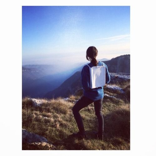 White Dodato at the End of the World.  #backpack #white #leather #mountains #sky #blue #fog #clouds #lessinia #italy