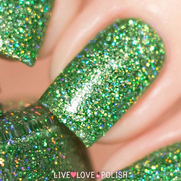 KBShimmer Smells Like Green Spirit is a dark lime green tinted base filled with silver holographic glitter.