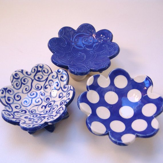 A gorgeous Delphinium Blue & White Dish Set of THREE flowers for ONE price! Beautiful embossed swirls, hand-painted curlyques & polka-dot pottery. The exact set pictured here -- Same dots, color & sizes from these photos They measure 4-4¼ across x 1 tall  They are fired with non-toxic lead-free glazes making them safe for food -- Sushi servers!! --or-- for soap, jewelry, ring dish, candleholder, spoon rest → an original one of a kind hand-built item, exactly as photographed  → Fin...
