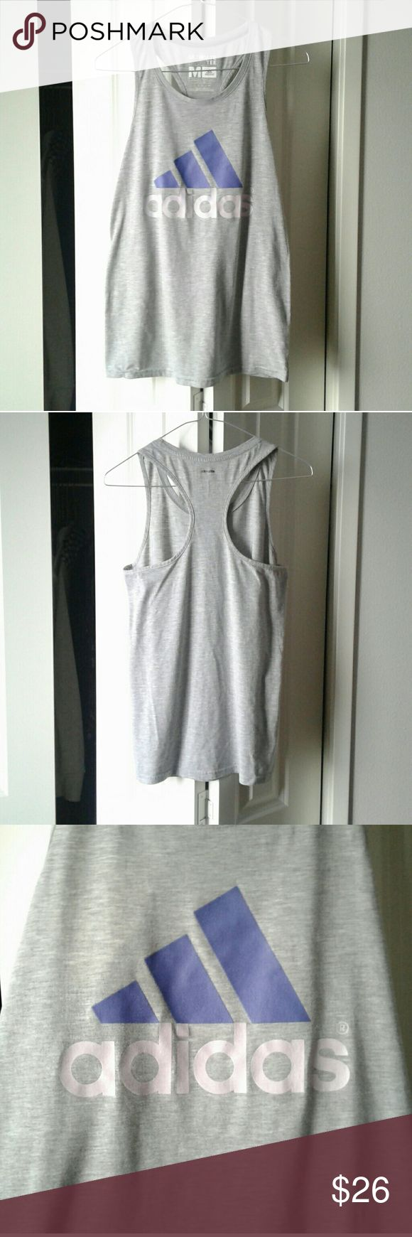 "⬇$26Adidas Logo Loose Tank Grey Adidas Logo Loose Tank  Style: Racerback Tank  Fit: Loose  Color: Gray  Straight Hem Design  Size M  85% Polyester, 15% Cotton  Large Adidas Logo and Lettering on Front  Front Colors: The ""adidas"" lettering is a light lavender purple. The signature adidas lines are a darker indigo purple.  Climalite Logo on Back in black lettering  Perfect for any workout, exercise, or just an easy lounge / athleisure top!  Pet-Free, Smoke-Free Home  Clean and in Excellent…"