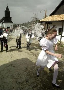 Young boys from the village of Holloko pour water onto the girls of the village in an Easter tradition in the tiny Hungarian village of Holloko