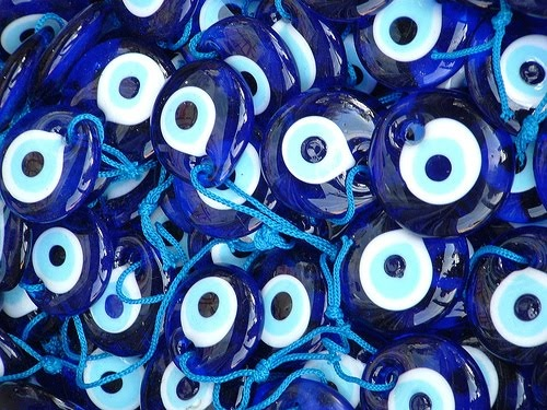 "Glass Eyes-of-God. Mediterranean peoples believe that the blue eye represents the eye of God and often wear or hang it in their homes to protect themselves and loved-ones from the ""evil eye""( malicious jealousy)."