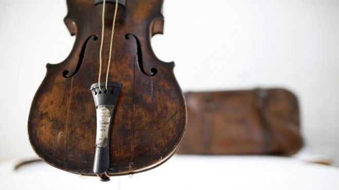 No, this is not just a picture of a violin. Read the story about it, it's really interesting.