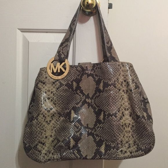 I just added this to my closet on Poshmark: Michael Kors Snakeskin Bag. Price: $125 Size: OS