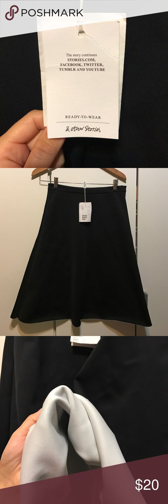 A line black skirt, could be a midi. & Other Stories black skirt inside is whit as shown on last picture, NWT. & other stories Skirts A-Line or Full