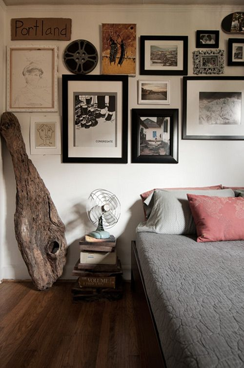 cool collection of objects in this portland bedroom. (the nightstands are made from found wood + dictionaries)