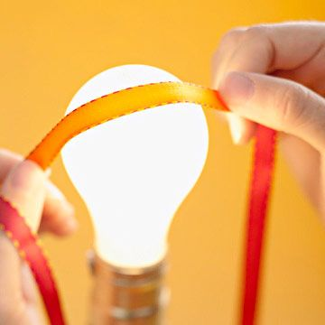 Get creases out of ribbon with a lightbulb.