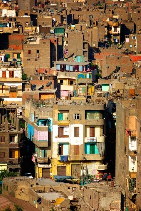A community in Cairo, Egypt adds pops of colors to their home to give their living quarters personality.