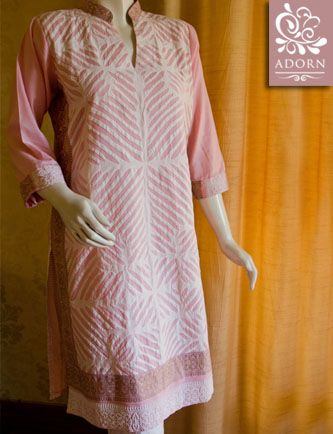 Pink with geometric rilli and a screen print back. For orders, najia@adorn.com.pk