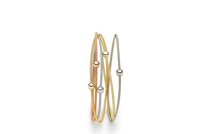 Niessing Colette Bracelet of gold or platinum swirl around your wrist. Combine different colours by intertwining several bracelets. Available from www.davidsonjewels.com