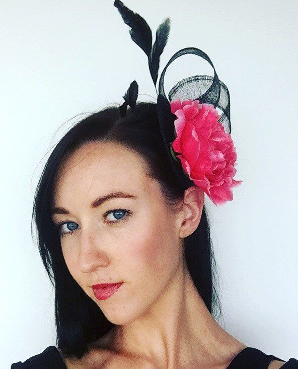A personal favourite from my Etsy shop https://www.etsy.com/au/listing/252122967/black-fascinator-decorated-with-hot-pink