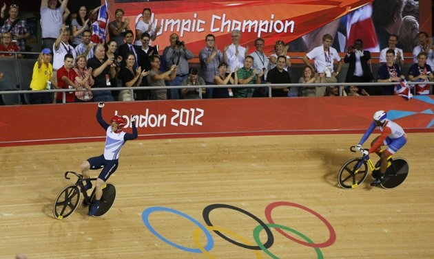 Britain's Jason Kenny celebrates defeating France's Gregory Bauge during the track cycling men's sprint gold finals at the Velodrome during the London 2012 Olympic Games
