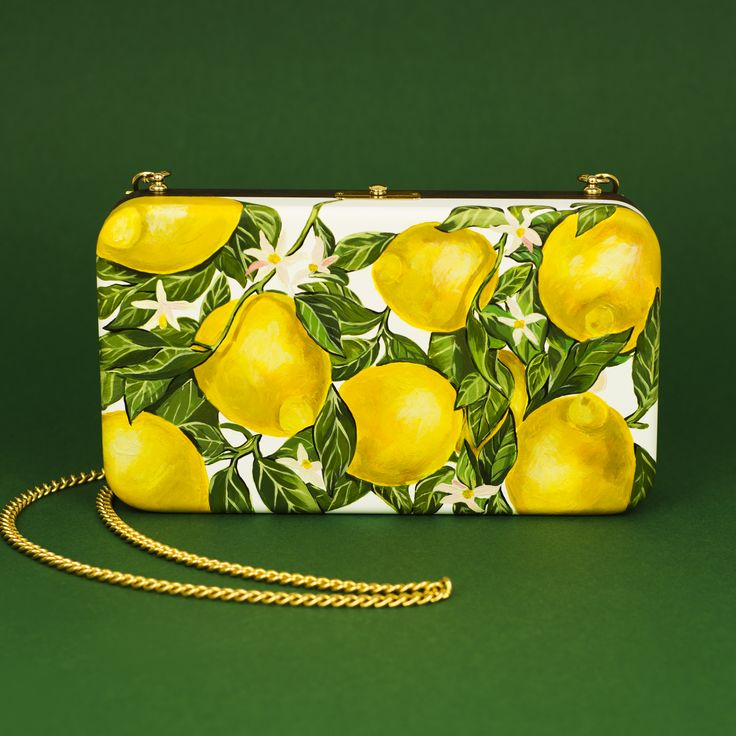 """Clutch """"Fresh lemons"""" on white background is made of natural wood beech. Backside of clutch is dark wooden, just polished. Weight of carcass about 300 grams. Pattern is hand-painted with acrylics and polished. Interior of the bag made of cotton lining. Long silver-tone chain is removable. Metallic silver-tone clasp fastening. Size of the bag - 23/13/5 cm.  Shipping: 5 -25 working days. World-wide courier delivery for free."""