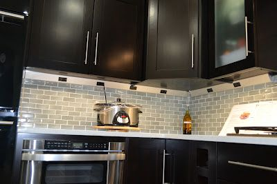"""rows of outlets """"hidden"""" right under the cabinets. Never run out of plugs, and you don't have to see them!"""