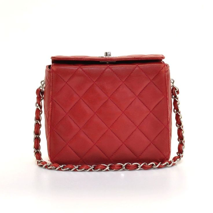 Authentic Chanel red quilted leather mini party bag. Top has CC twist lock. Inside has black leather lining and 1 pocket with zipper. Hardware is in silver color. #Chanel #Handbag @fmasarovic