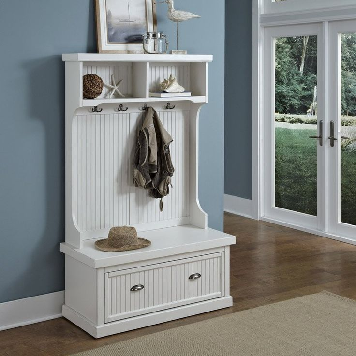Nantucket Distressed White Hall Tree - Keep things organized and on-trend with the chic Shaker style of the Nantucket Distressed White Hall Tree. Crafted of hardwood solids and engineered w...