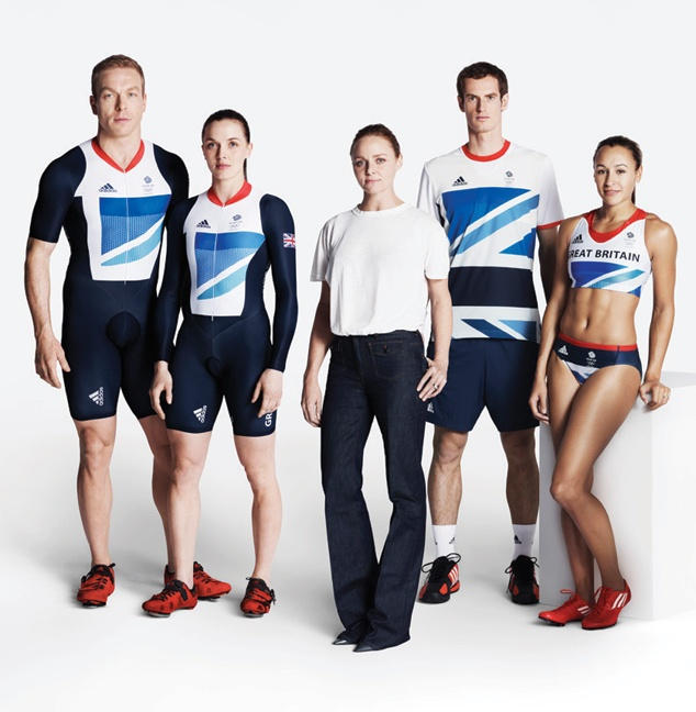 Stella McCartney with members of the Great Britain Olympic Team in uniforms designed by McCartney for Adidas.