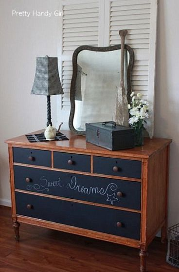 A plain wooden dresser got dressed up with chalkboard painted drawers. The