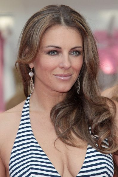 Elizabeth Hurley Long Curls - Elizabeth Hurley styled her hair in center part curls for the Beach Boutique opening.