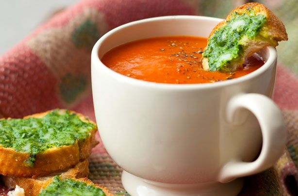 Red pepper and tomato soup - cheesy pesto croutes are the perfect side to this warming homemade soup recipe.