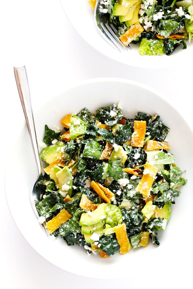 This Mexican Caesar Salad recipe is THE BEST! It's made with lots of avocado, crispy tortilla chips, kale, pepitas, queso fresco, and a delicious Greek Yogurt Lime Caesar Dressing. Love it!   gimmesomeoven.com