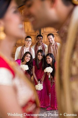 An Indian bride and groom add a touch a class as they wed in a traditional Hindu wedding ceremony. They choose bright and bold colors like red and blue for their wedding fashions.