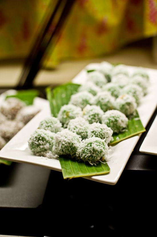 Malaysia Nyonya Pastry: Onde-onde (Glutinous rice flour infused with screwpine leaf juice rolled with fresh grated coconut, and filled with palm sugar that bursts in your mouth when you take a bite).