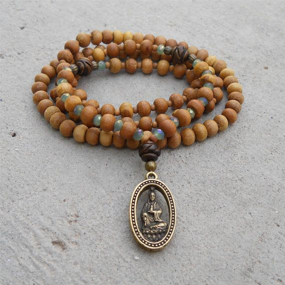 Quan Yin -108 bead mala yoga bracelet, Aromatic Sandalwood, and Tibetan hand made pendant of Quan yin