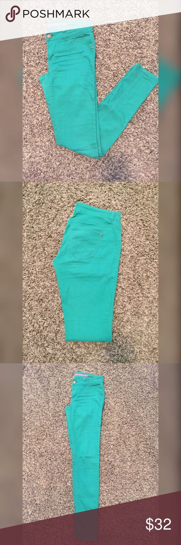Tilly's Solid Green Teal Skinny Jeans These are green teal skinny jeans from Tilly's. They have two pockets on the back. They have one button & zipper on the front. These jeans are a size 3. Tilly's Pants Skinny