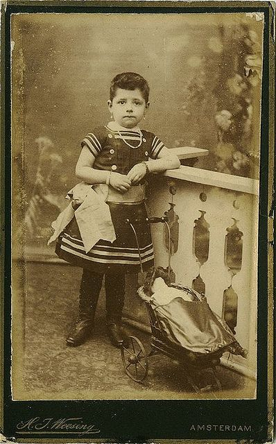 Antique Photo Album: Girl with doll in stroller by Antique Photo Album, via Flickr