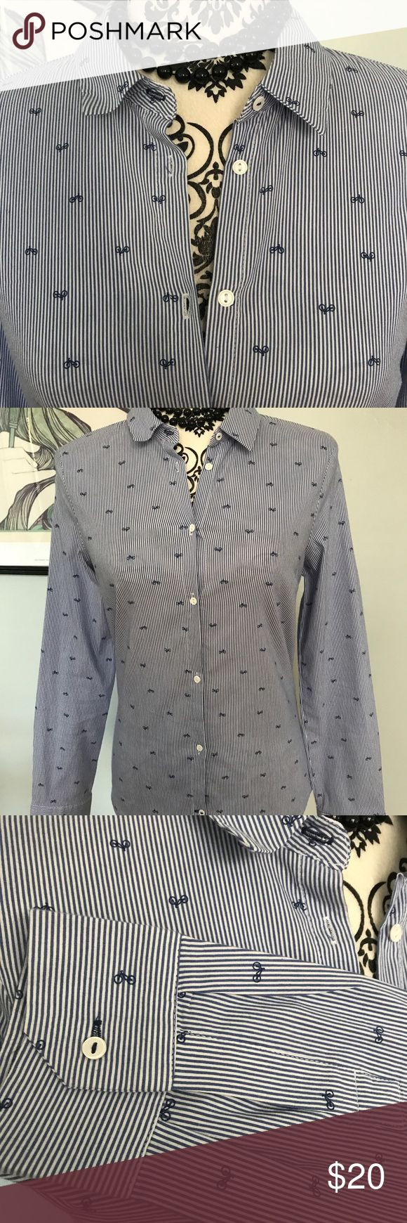 "Zara Oxford-style shirt with bicycle print Excellent used condition! This is a darling Zara Oxford-style button-up shirt with blue and white stripes, plus an adorable print of small (navy blue) bicycles. Delicate white buttons at front and sleeves. Sad reposh, because this was too tight in the bust. Underarm to underarm is approx 15.5"". The dress form's bust is approx 33.5"", and I wouldn't go any tighter than that (minimal to no stretch). Back neck to hem approx 26.5"". Perfect for work or a…"