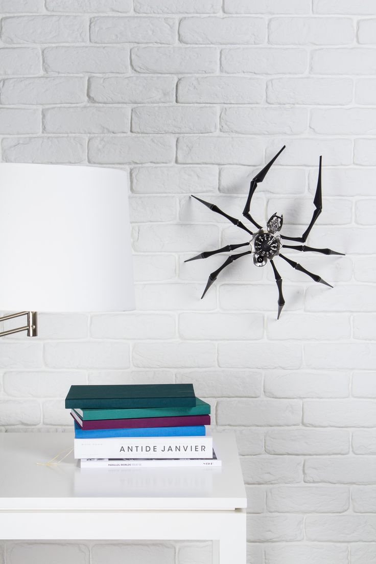 Arachnophobia is more than a table clock - it's a wall clock too!