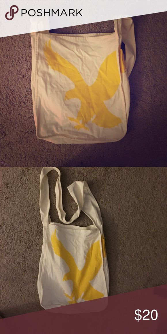 AMERICAN EAGLE TOTE American Eagle tote. HUGE!! Crossover bag. White and yellow. HUGE eagle on front! Great condition!!😍💝 American Eagle Outfitters Bags Totes