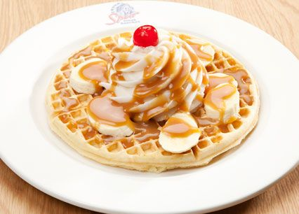 Home-made Waffles. Our traditional home-baked Spur waffle, topped with soft serve and caramel syrup. Drizzled in either toffee fudge sauce and sliced banana or Bar-One sauce at Spur Steak Ranches   http://www.spur.co.za/menu/desserts