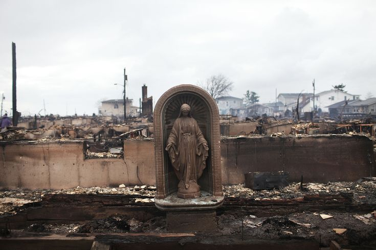 A Virgin Mary is all that remains from a home that was destroyed in Breezy Point, Queens, after Hurricane Sandy.