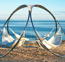 Trinity Hammocks...INFINITY Model Stainless steel  structure  21''diameter suspended teak table  handwoven acrylic yarn  hammocks or quilted hammocks PVC  cream colored top  Base : 10 '  -3 meters (diameter) Height :  8.5 ' – 2.8 meters Weight :  140 lbs – 64 kilos