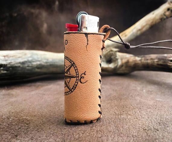 Genuine leather pouch in natural color. The design was burned with pyrographer. The compass design can be replaced with your own design, logo, monogram, initials.... Please contact me for costumisation (NOT EXTRA CHARGED) WHY TO BUY All my items are made with Genuine Greek Leather, with