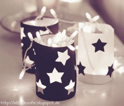 Too cute use star punch on dark blue paper to wrap small frosted candles and the left over stars on the white.