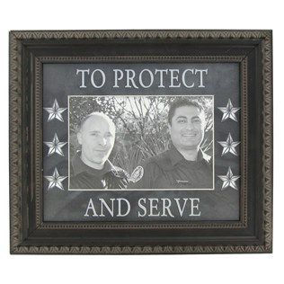 """This Protect & Serve Police Photo Frame is a great gift for the special police officer in your life. The frame has a 5 1/2"""" x 3 1/2"""" photograph opening and the outside dimensions are 9 7/8"""" x 8 3/4"""". The frame has an easel back and has hanging hardware that allows you to hang the frame either vertically or horizontally."""