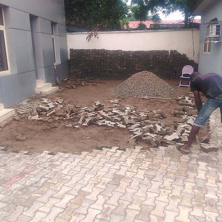 Available parking space for the construction of the waiting area between two structures and removal of landscape bricks at the passport office IKOYI Lagos. #construction #constructionworker #3ddesign #design #immigration #heritagebank #bankingindustry #woodworker #wood #carpentry #carpenter #woodworking