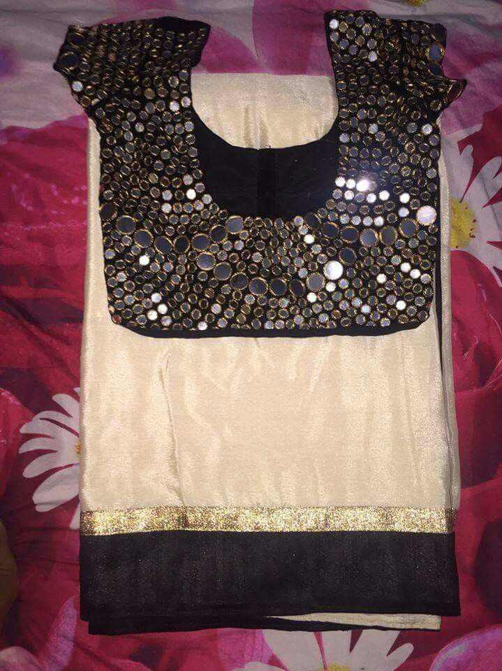 Cream color saree border lace combination is black and gold lace saree with black color blouse to using gold tread round mirror making work design blouse.