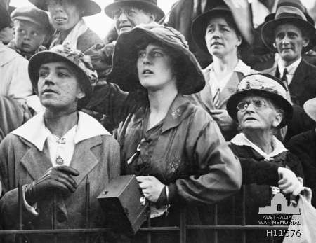 """Australia, 1918 --  """"A group of women are a study in expressions at the ANZAC Buffet in Hyde Park, Sydney where relatives waited to welcome home their loved ones."""""""