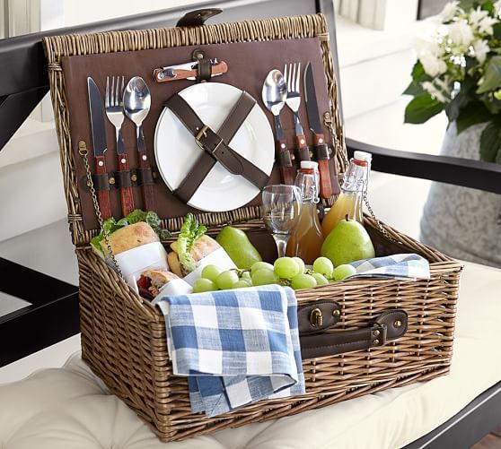 12 Wedding Registry Items for an At-Home Date Night | Take a hike, or just pack a picnic for the backyard. This picnic basket set includes two sets of wine glasses, plates and flatware for fine dining outdoors.