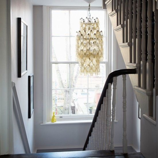 Chandelier over traditional Victorian stairs
